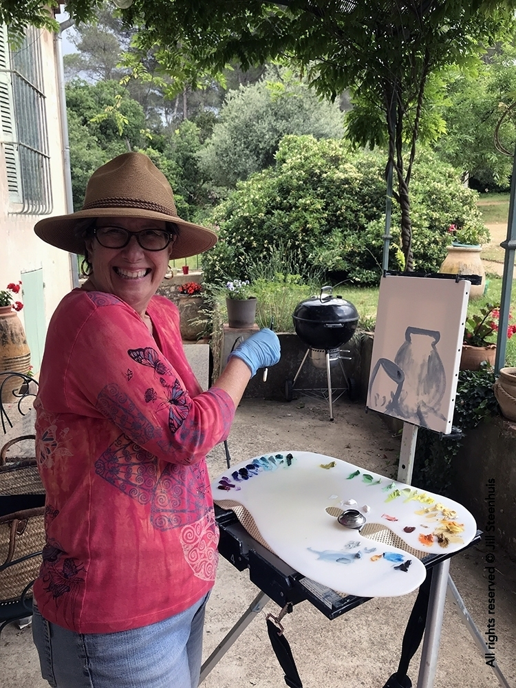 Workshopper painting en plein air on a French terrace