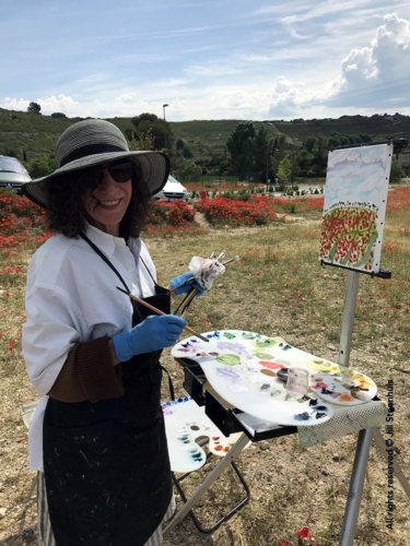 Workshopper painting poppies in Aix Landscape